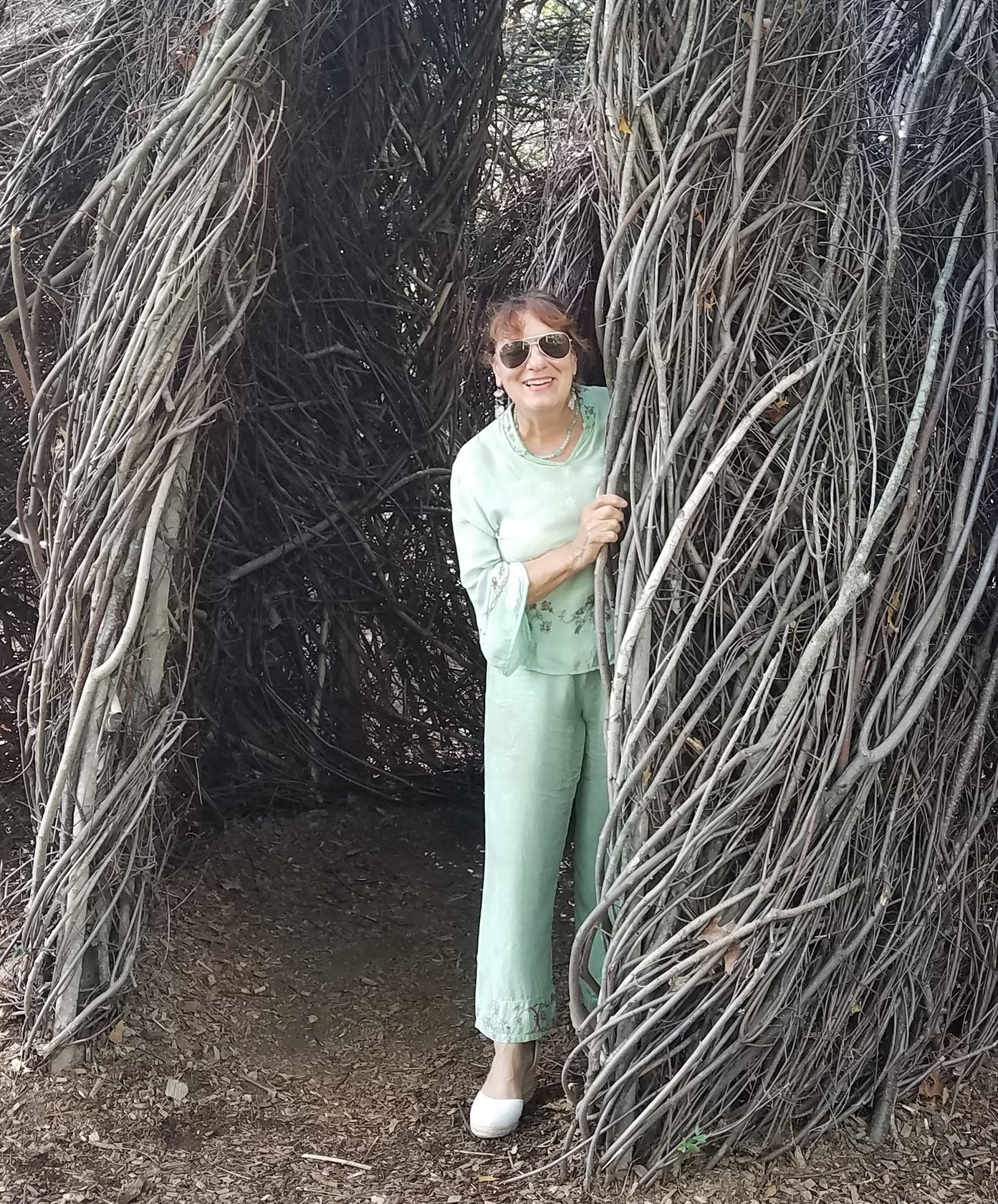 Dr Roxie inside the Botanical Garden installation by Patrick Dougherty.