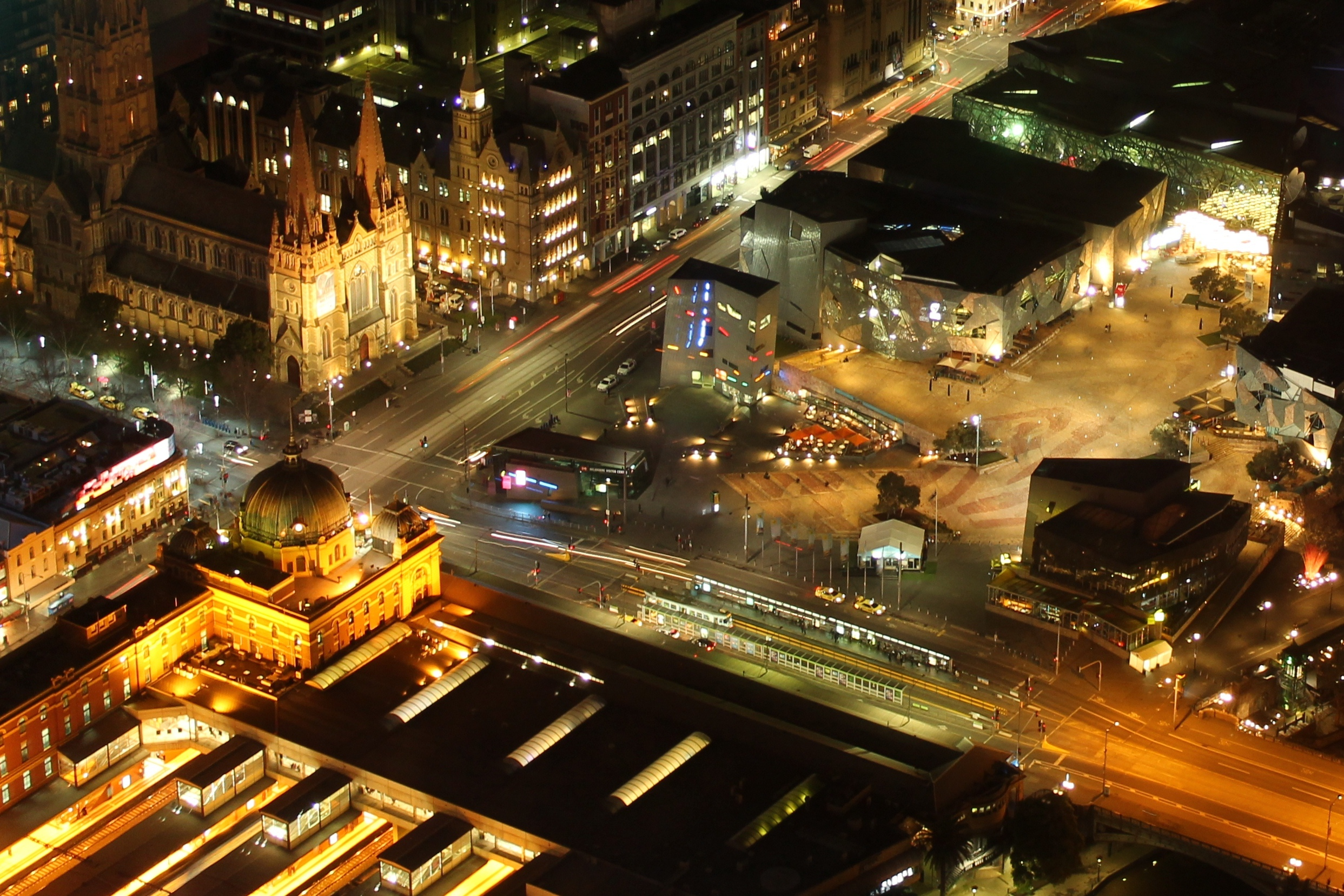 Many buildings, such as those at Flinders Street and Federation Square, are floodlit at night for aesthetic reasons. Photo: Anne Aulsebrook
