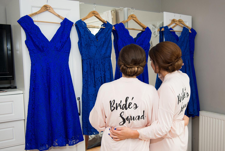 Bridesmaids looking at their bridesmaids dresses