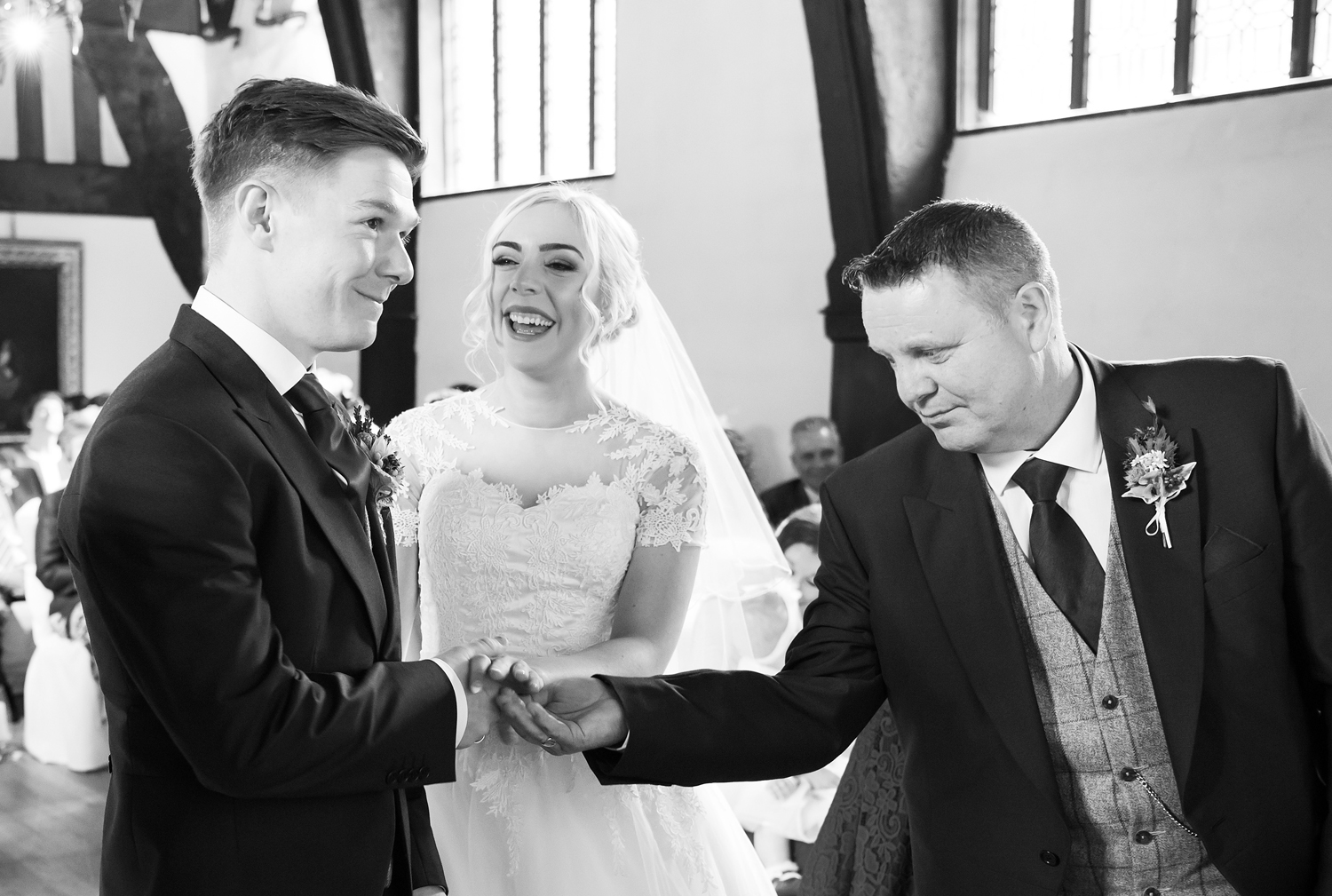 Father of the Bride hands over his Daughter's hand in marriage at Samlesbury Hall