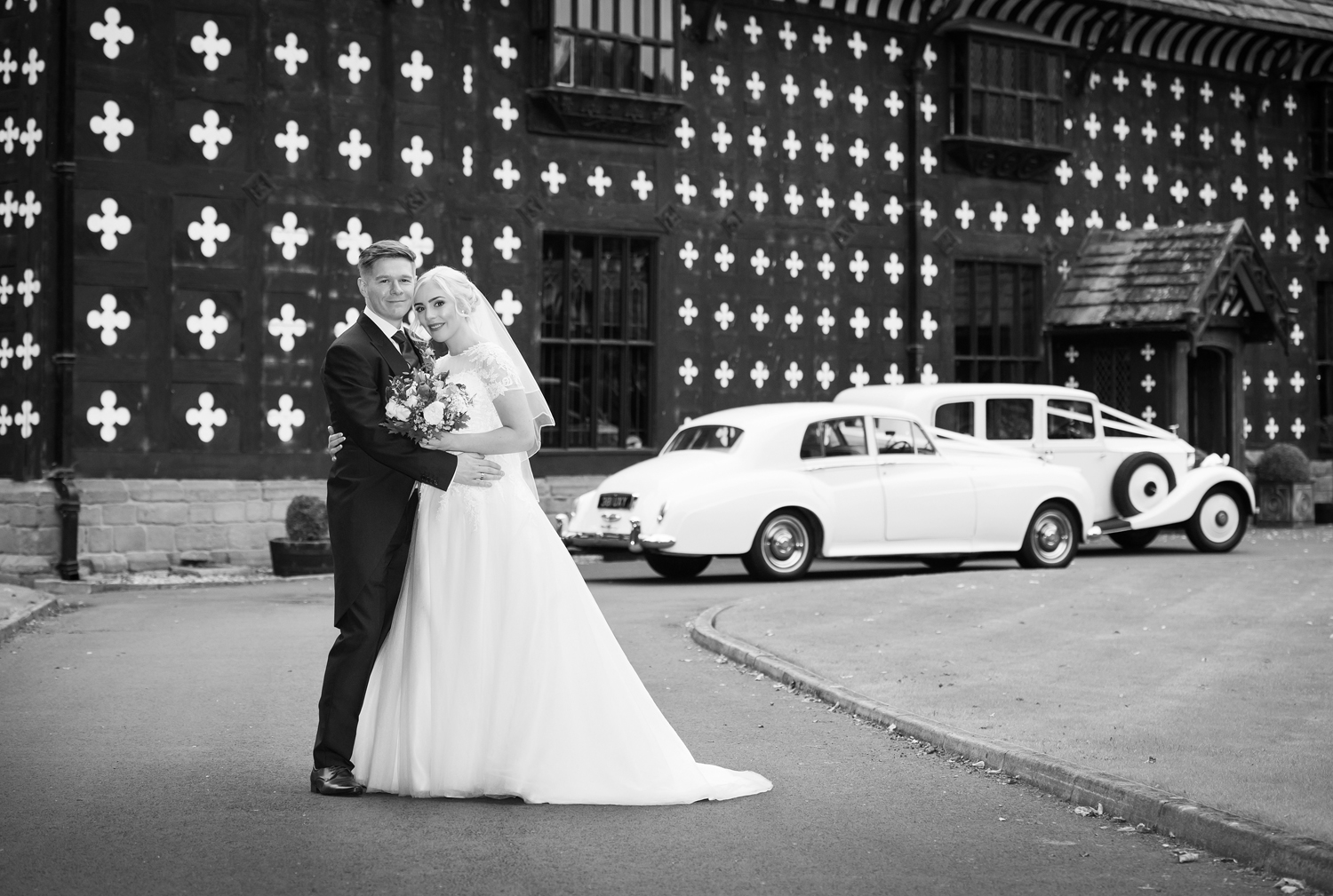 Bride and Groom photographed in front of Samlesbury Hall