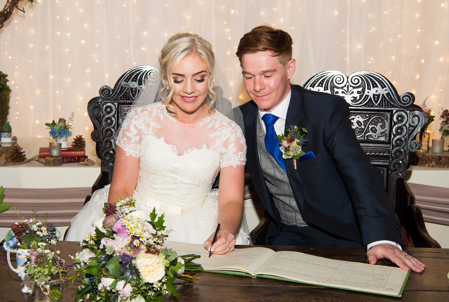 The signing of the wedding register at Samlesbury Hall