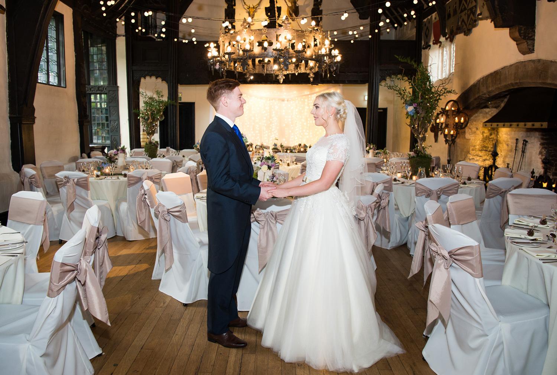 Bride and Groom photographed before their Samlesbury Hall wedding breakfast