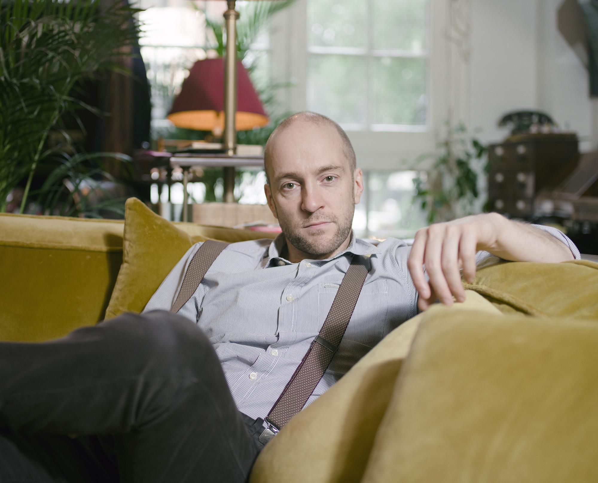 Derren Brown sat on sofa