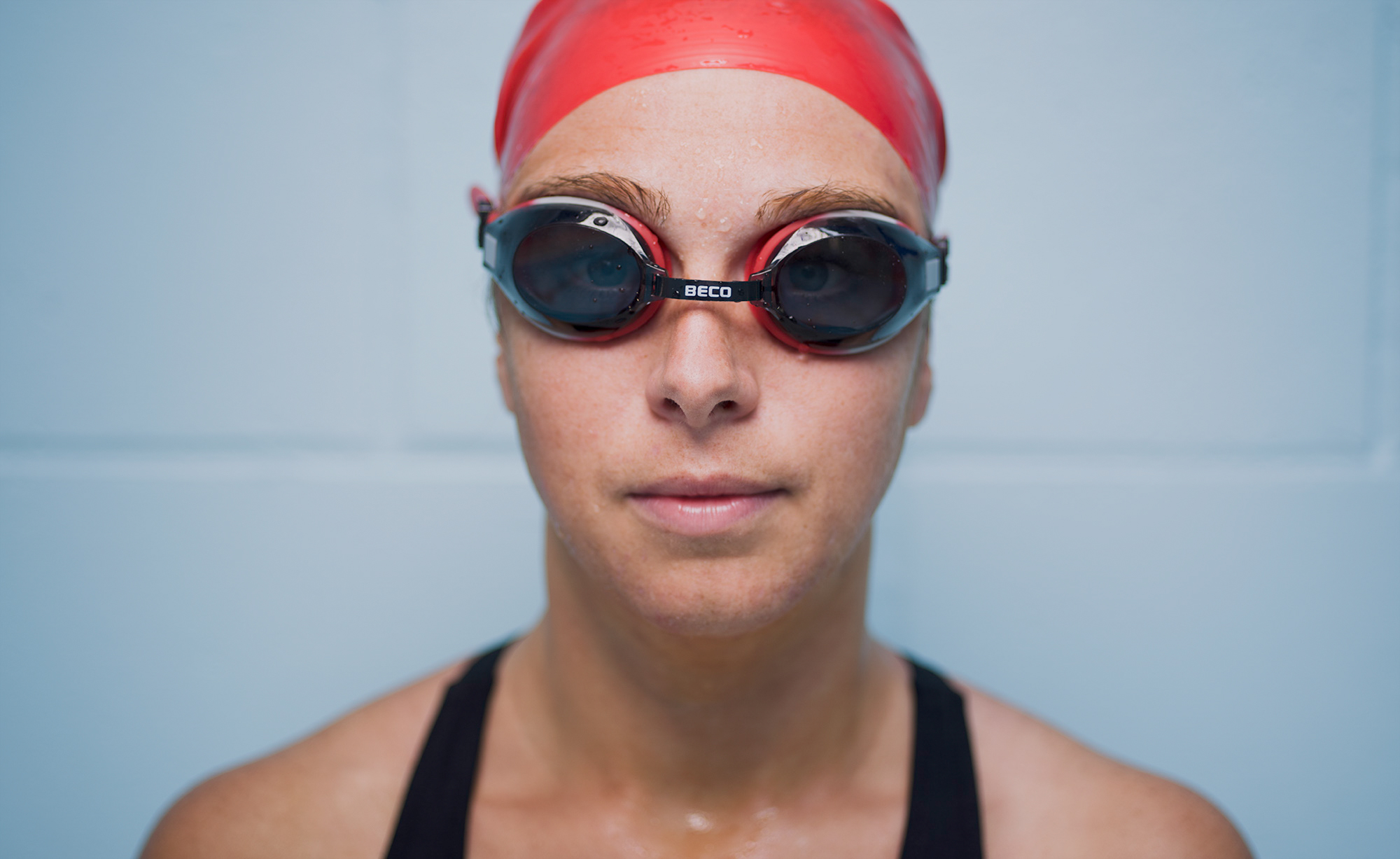 Swimmer portrait in cap and goggles