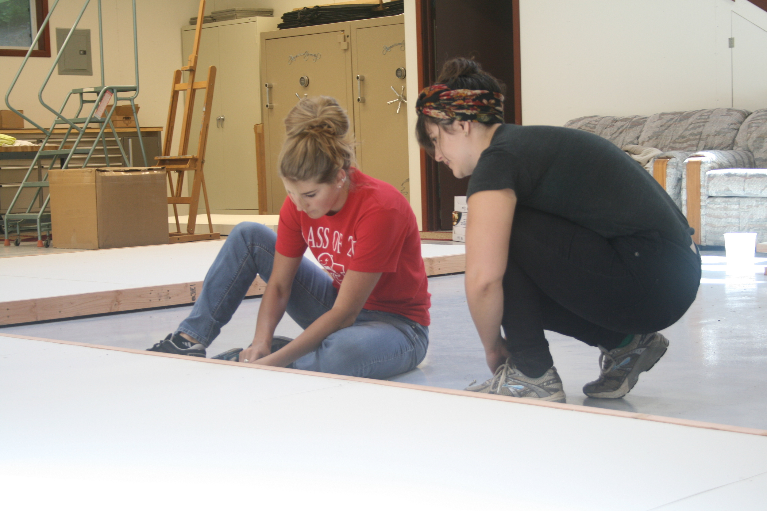 Project 387 intern Jeannette Stefani and board member Sarah Koik finish up the framing.