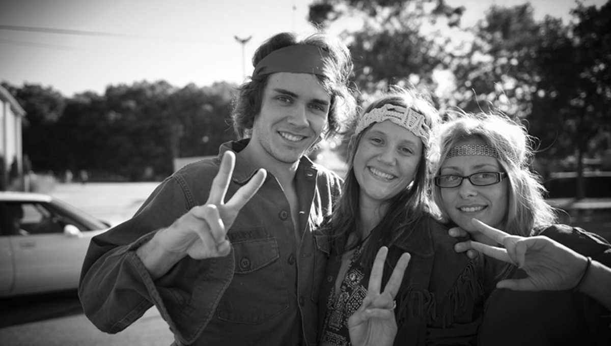 Hippie actors hired to protest the reunion (Peacefully of course)