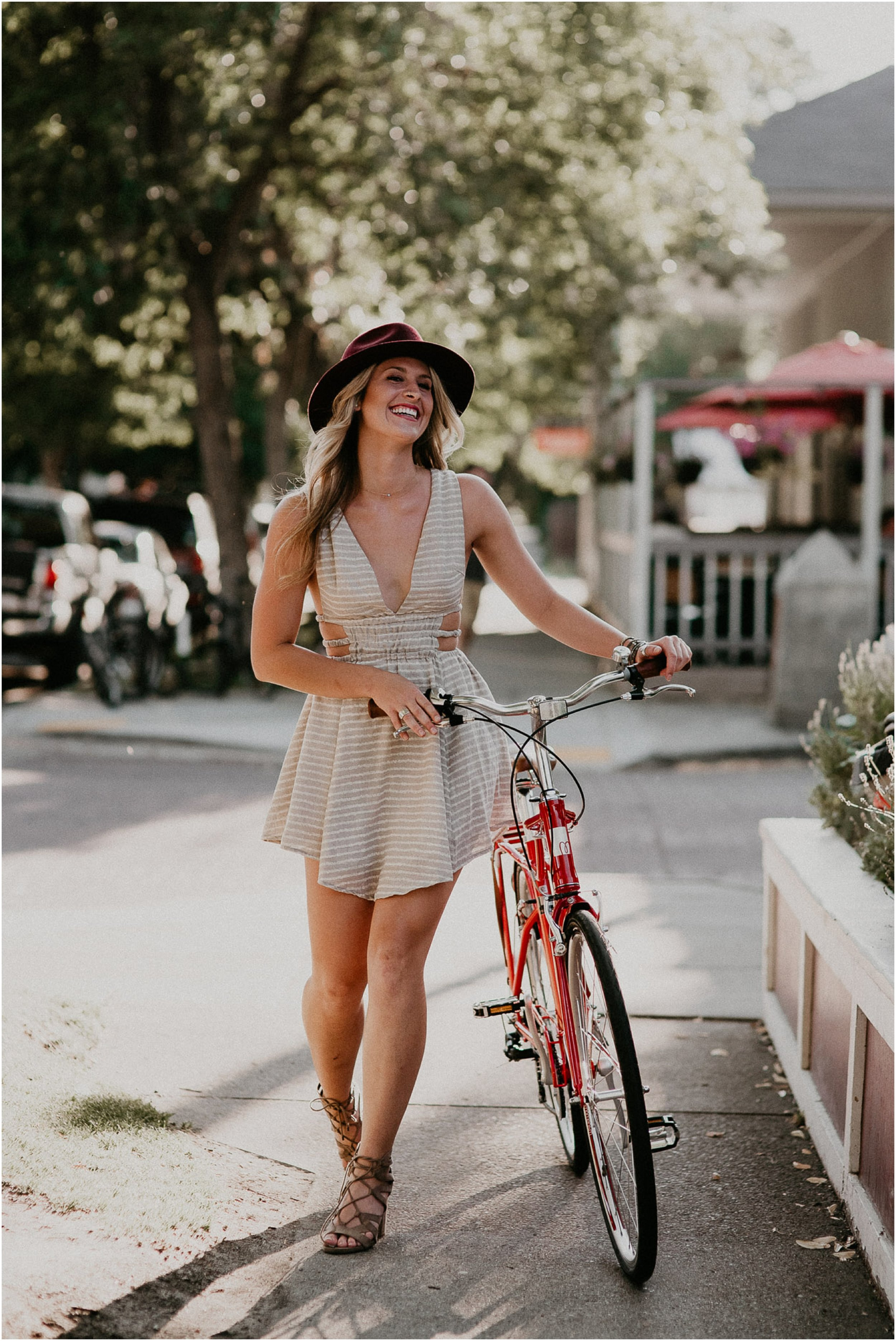Boise Senior Photographer Makayla Madden Photography Downtown Boise Bike Laughter Styling Boho Idaho Hyde Park Dress Senior Outfit Ideas Swank Boutique