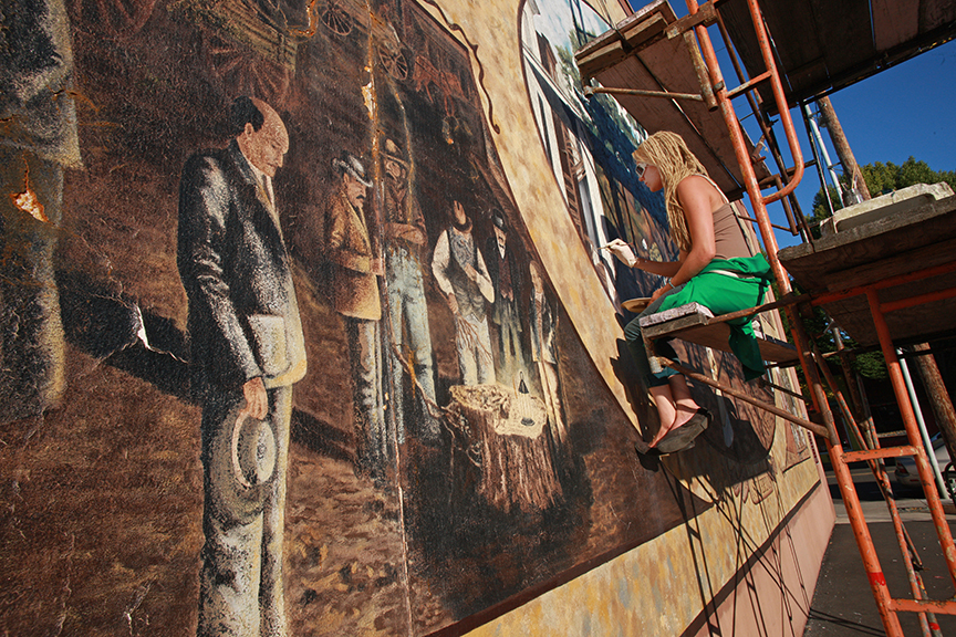 Artist Tanya Smithburg for the Silverton Mural Society painting the history of this once thriving timber community.