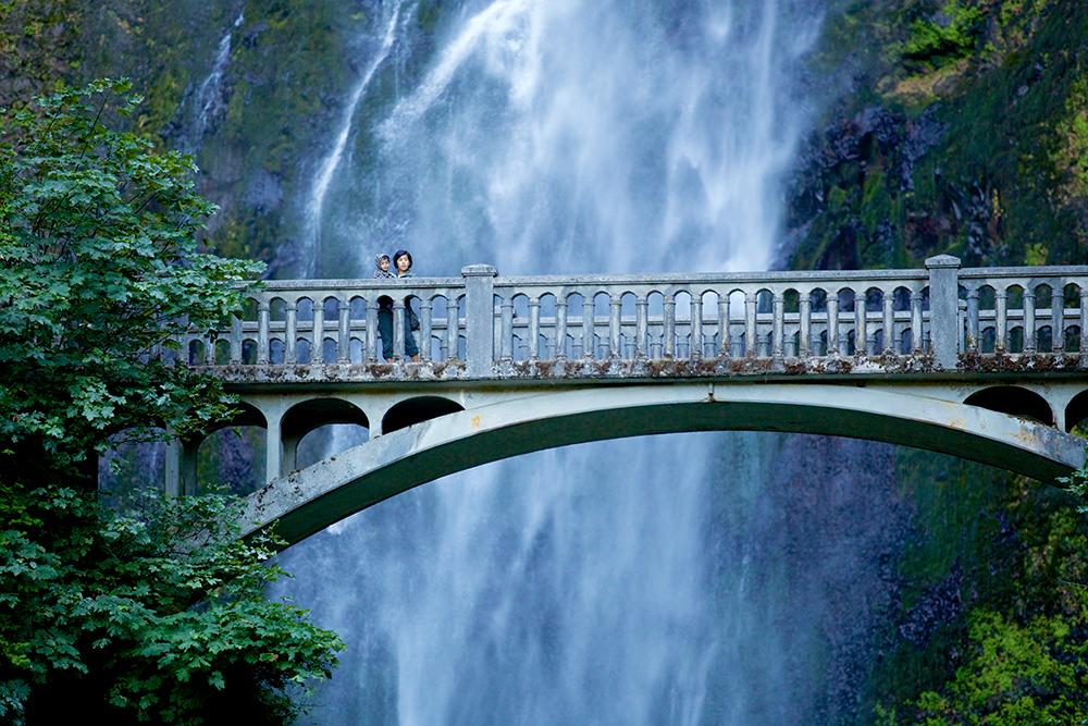 Melanie and Deven Panhcal of Seattle visit Multnomah Falls.