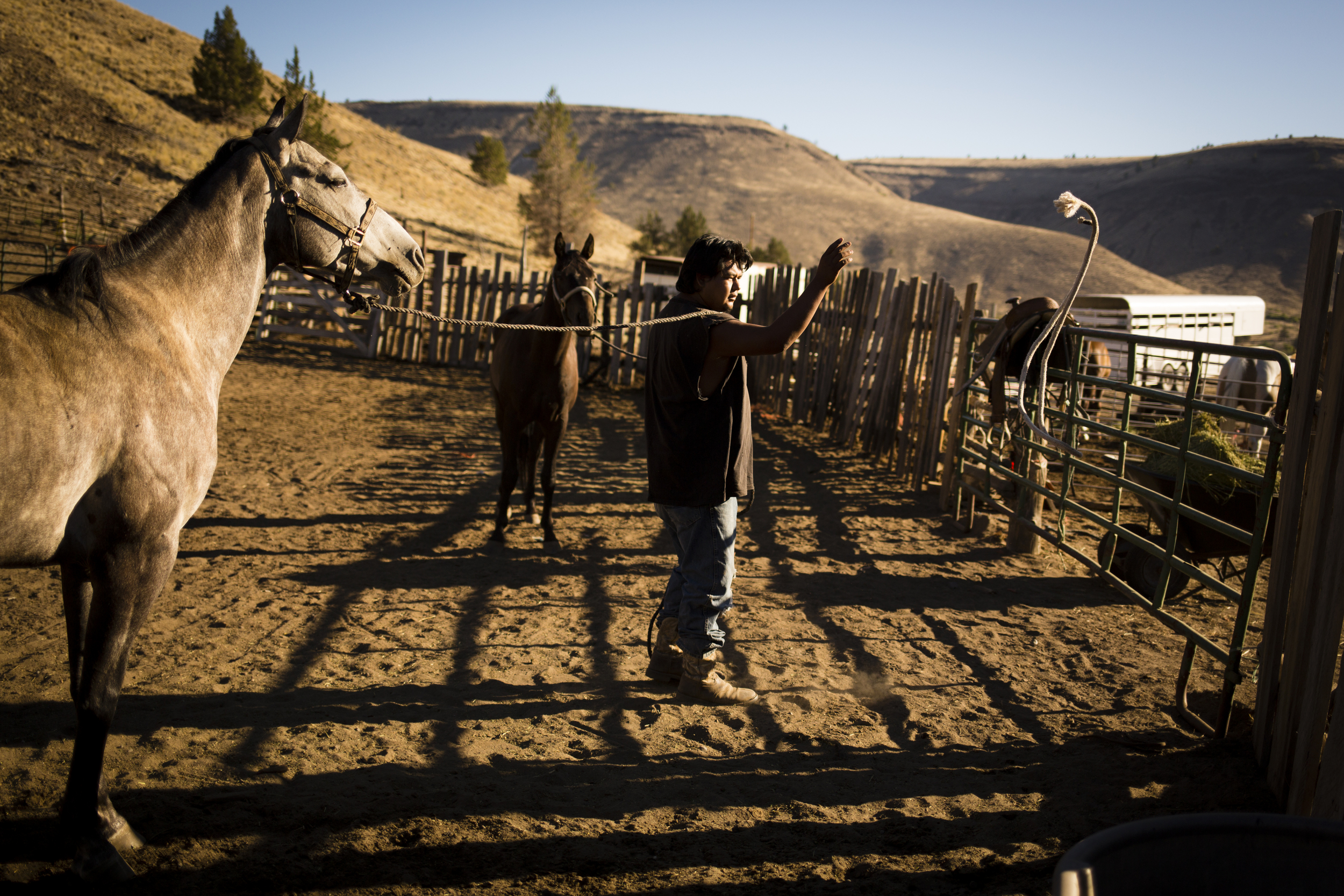 Leslie Rae Robinson tends horses on his grand aunt's property in Warm Springs.  Photo by Leah Nash