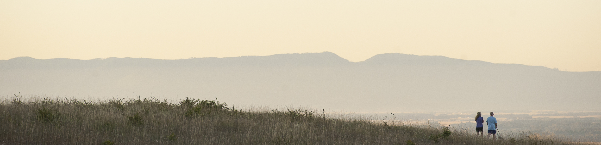 An unidentified couple walk their dog at 6:15 a.m. at Fitton Green Natural Area just outside Corvallis.  Photo by Andy Cripe