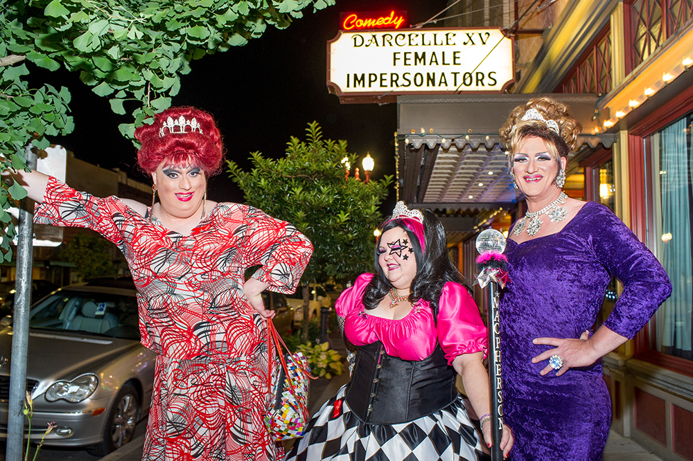 Female impersonators Wayne Chamberlain/Miss Gay Portland, left, and Allen Cole/Miss Gay Oregon, right,  join Ms. Gay Oregon/Jennifer Martin, center, outside Darcelle XV Showplace in Portland.  Photo by Paul Engstrom