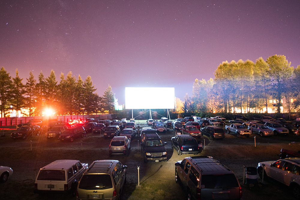 "Movie goers watch ""The Lone Ranger"" from their cars at the 99W Drive-In movie theatre, in Newberg, OR.  Photo by Chase Allgood"