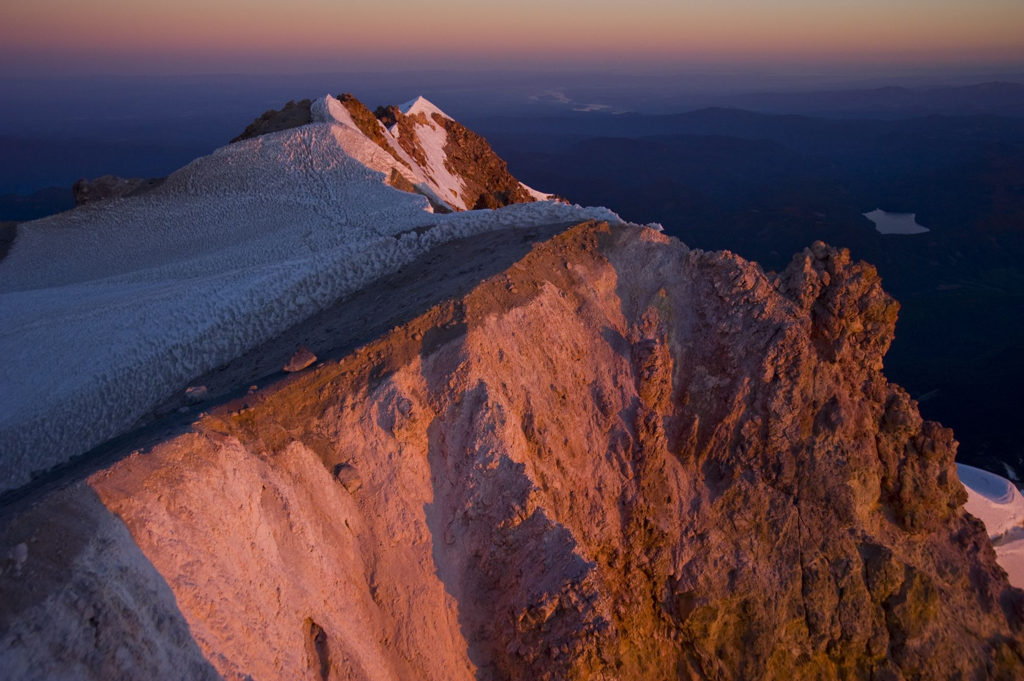 Mt. Hood summit ridge with Columbia river in the distance.  Photo by Peter Marbach