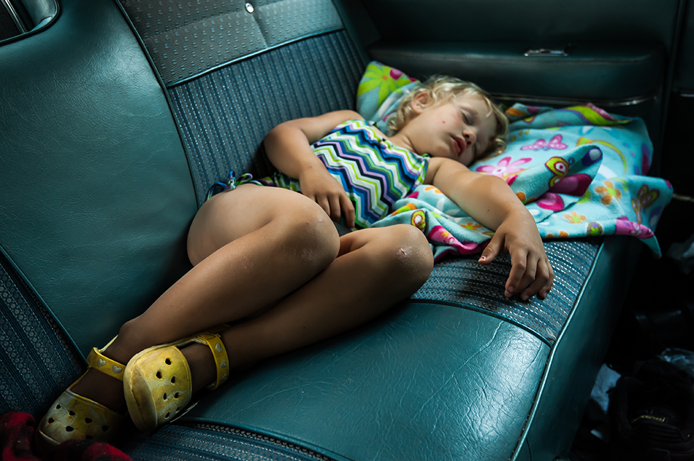 Fionnuala McManama, three, sleeps off a busy day floating the Clackamas River at Barton Park in the back of her mom's 1964 Impala.  Photo by Beth Buglione