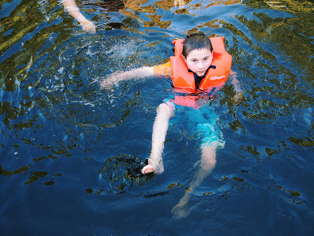 Eight-year-old Tyler Kish came to the ROck Creek Swimming Hole in Vernonia, Ore., to practice his swimming skills with his mother, Traci Kish.  Photo by Natalie St. John