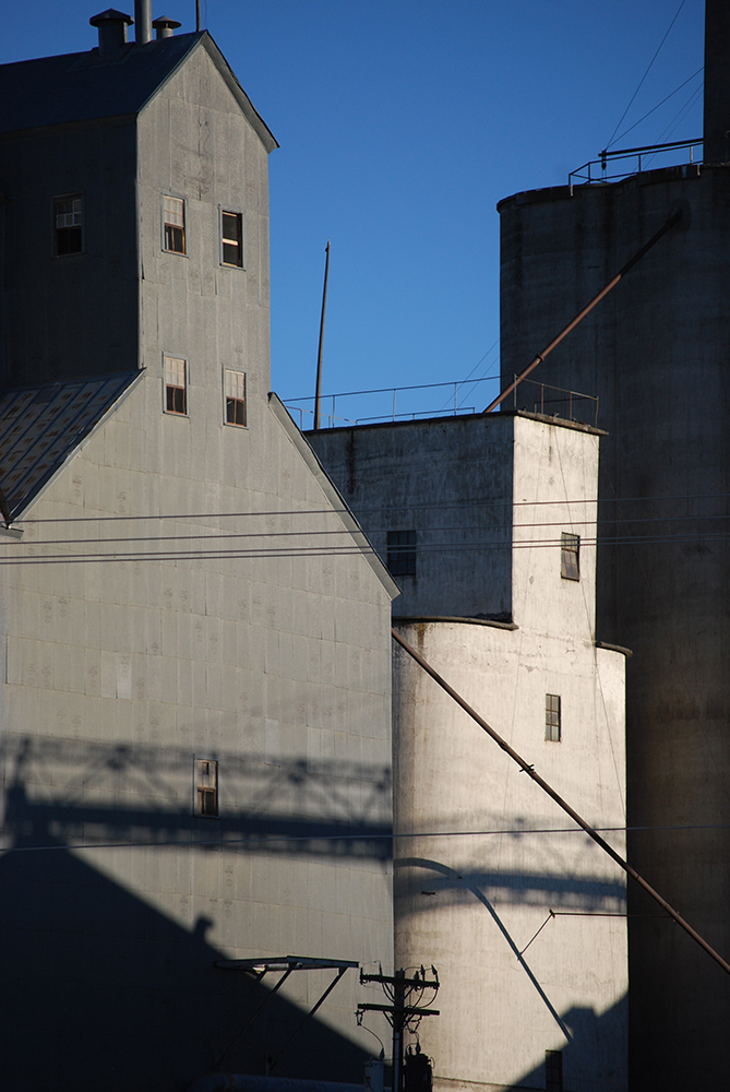 Mid-Columbia Producers' grain elevators from highway 19 in Condon.  Photo by McLaren Stinchfield