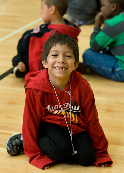 A young student wears a big grin while waiting for his class to begin at the Dual Language Academy, a program taught in both English and Spanish and run concurrently with the district's migrant summer school program at Lincoln Street Elementary.  Photo by Michal Thompson