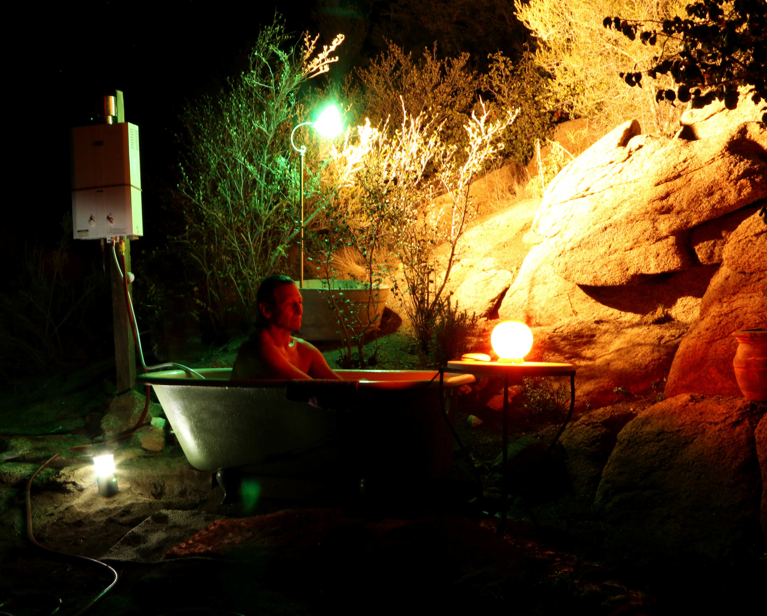 Enjoying our outdoor bathroom where we can take a bath anytime day or night becasue of endless hot water.