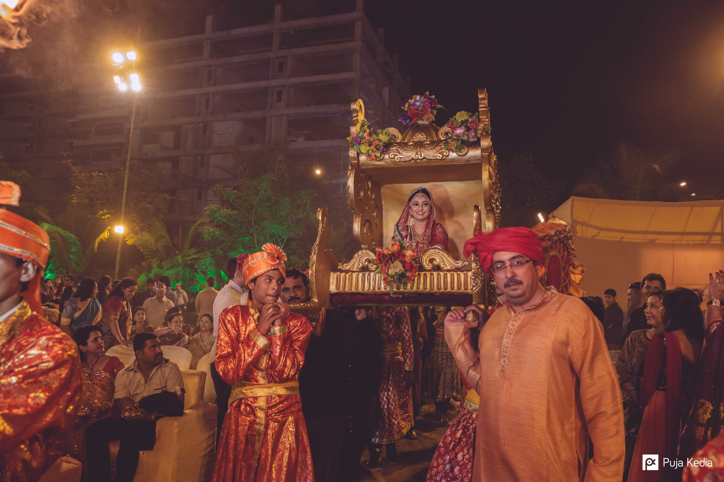The Bride's Maternal Uncle escorts her to the Mandva.