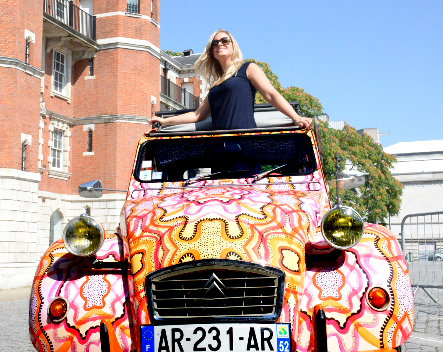 Liz Nehdi in Orangina II, a 1974 Citroen 2CV turned into art