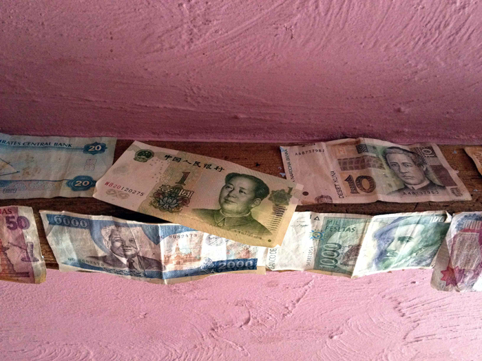 Foreign currencies taped to the ceiling of The Nut Tree Inn