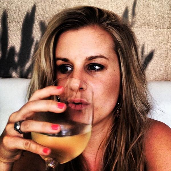 Liz enjoys a massive glass of white wine