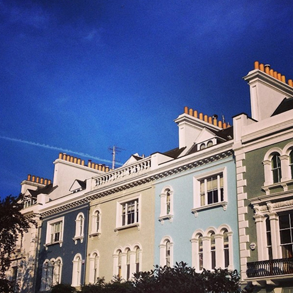 Pastel and neutral houses against a brilliant blue sky in Westbourne Park