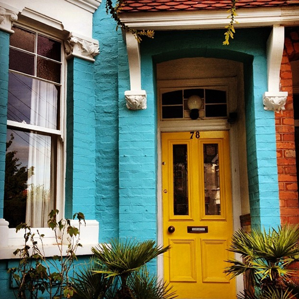 This yellow door really pops against the turquoise façade