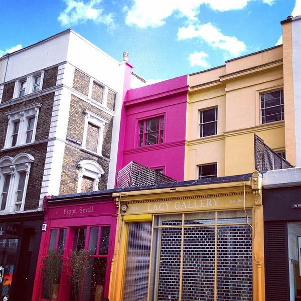 Brilliant magenta and yellow facades look particularly lovely against a blue sky