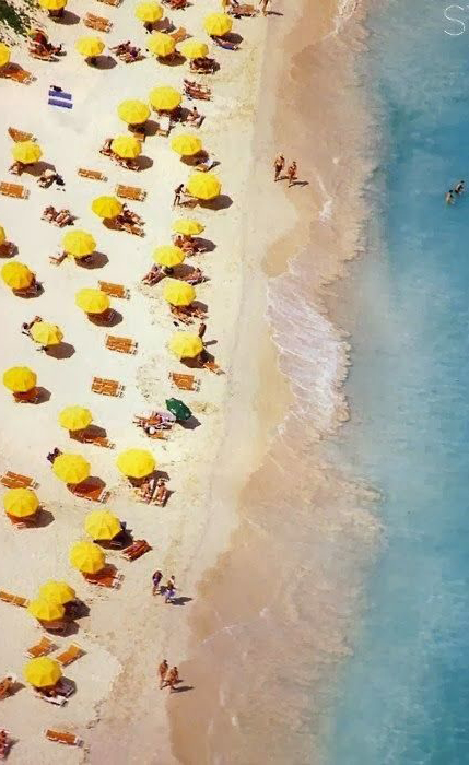 Photo of yellow umbrellas at the beach by Slim Aarons via  Style Takes Heart  - lots of additional Slim Aarons photos here as well!