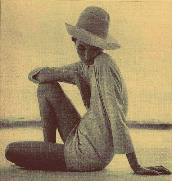 Woman sitting on a beach in a tunic via Pinterest