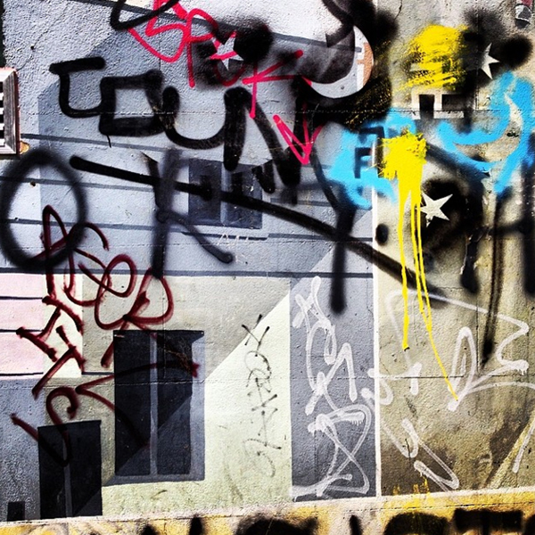 Layers of graffiti on a wall just off Portobello Road in Notting Hill. Yes, I love traditionally beautiful things and scenes, but I'm also attracted to a bit of grit. The combination of lyrical tags, alternation between hard lines and blurred edges and pops of bright colour against a slightly textured neutral background draw me in