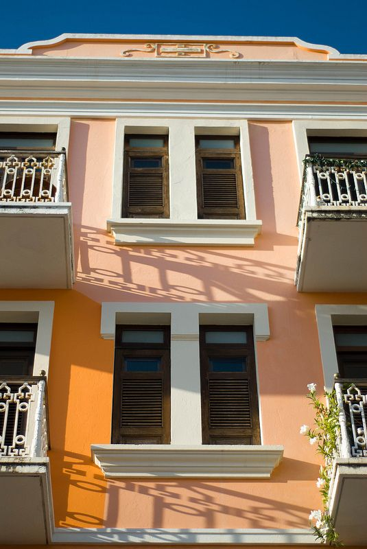 Orange facades in old San Juan via the lovely and talented  coolsneakers2000