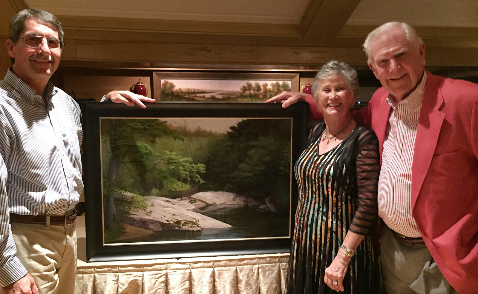 Jason showing his new painting River Bend with buyers Jim & Barbara Whitton