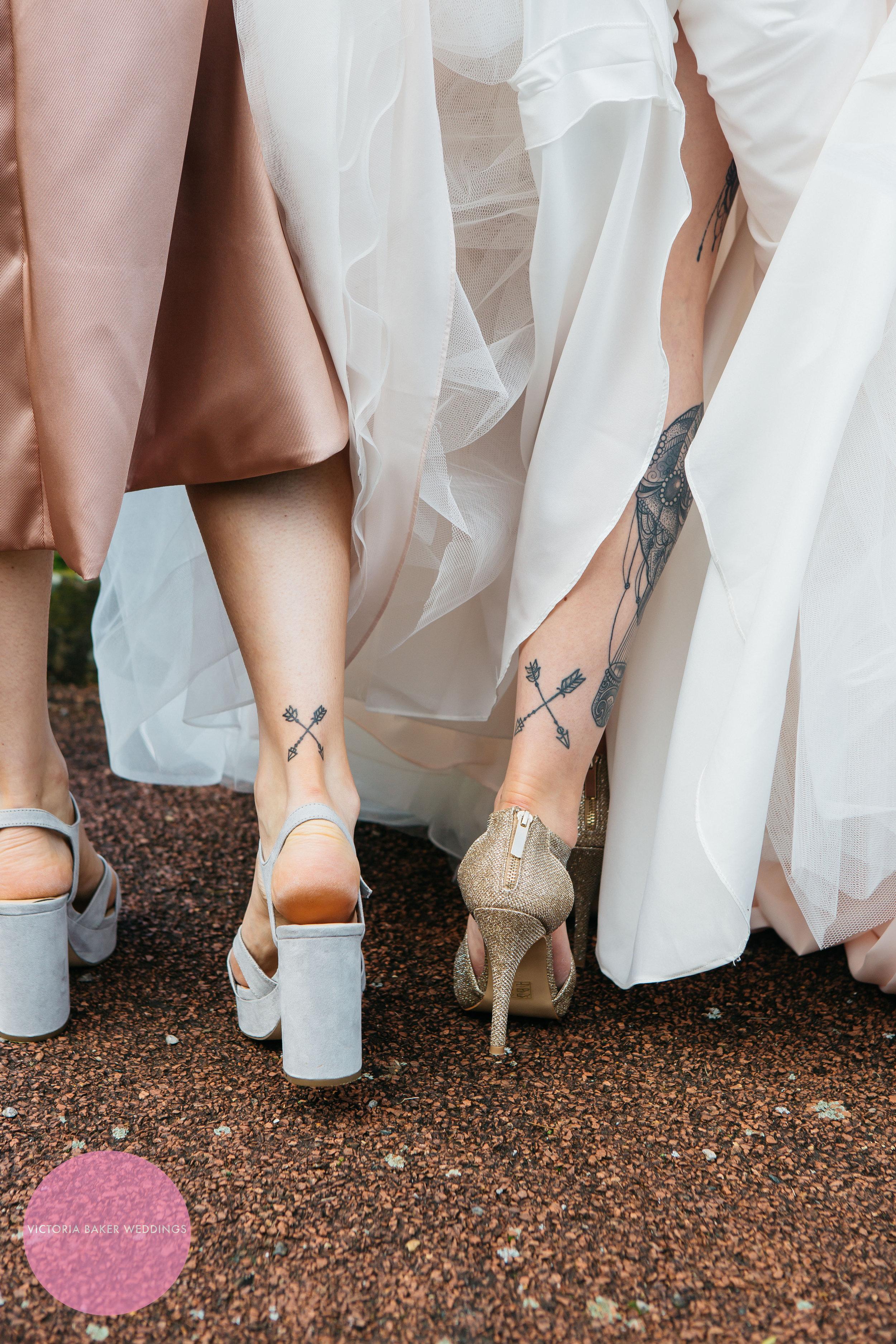 Matching tattoos at Oulton Hall Wedding