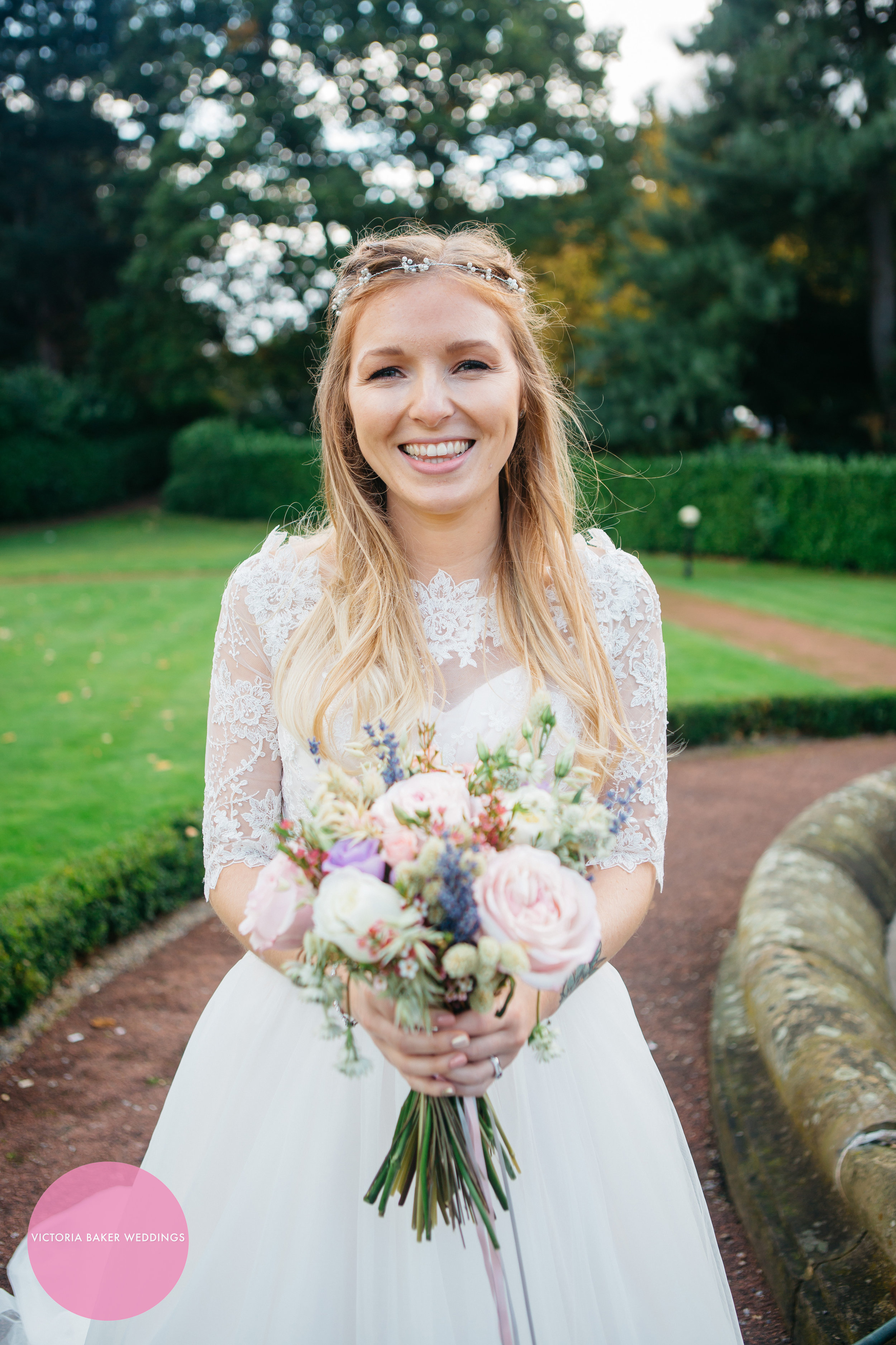 Bride with flowers at Oulton Hall Leeds