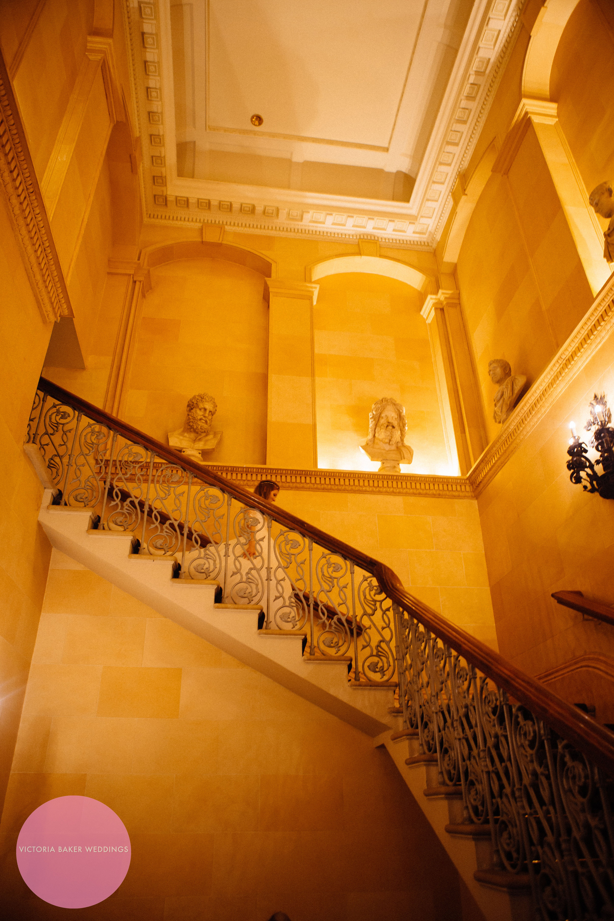 Bride on famous staircase Oulton Hall Leeds