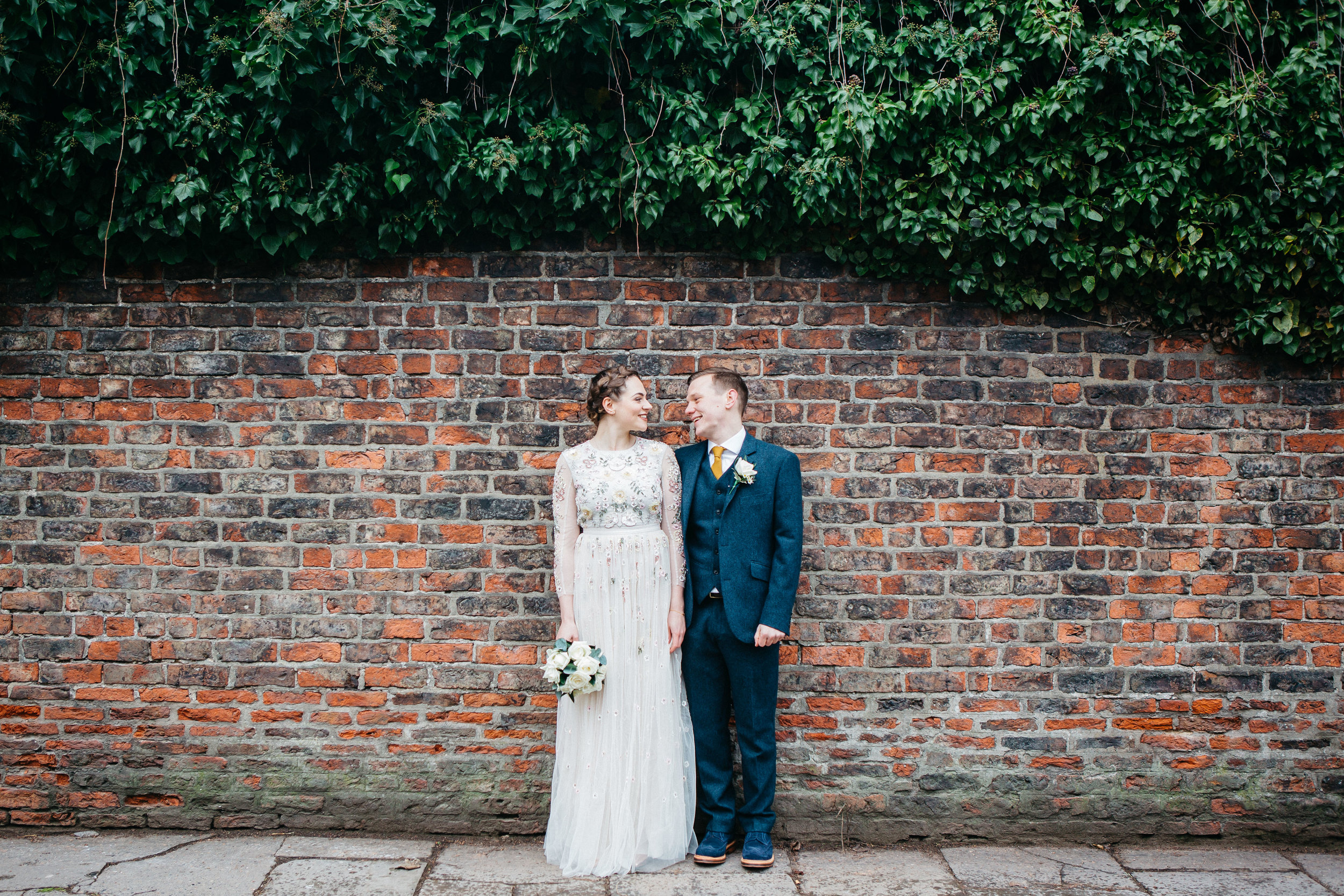 Bride and Groom York brick wall
