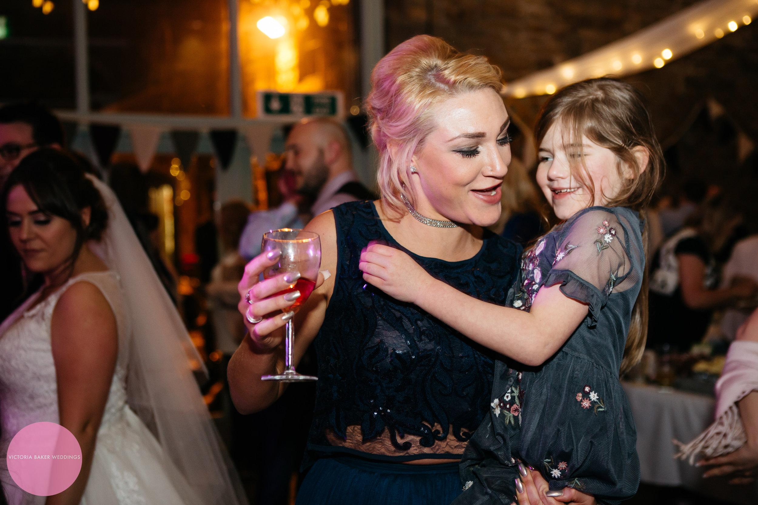 Wedding party dancing bridesmaid