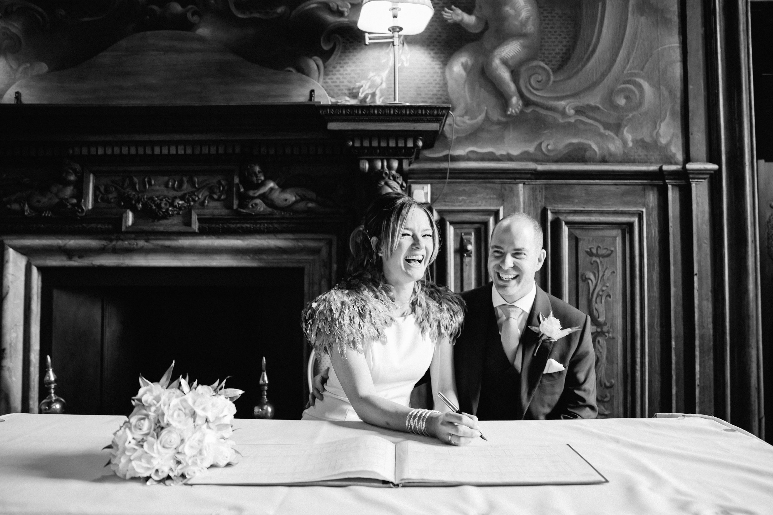 Bride and groom signing register at Moor Park Rickmansworth