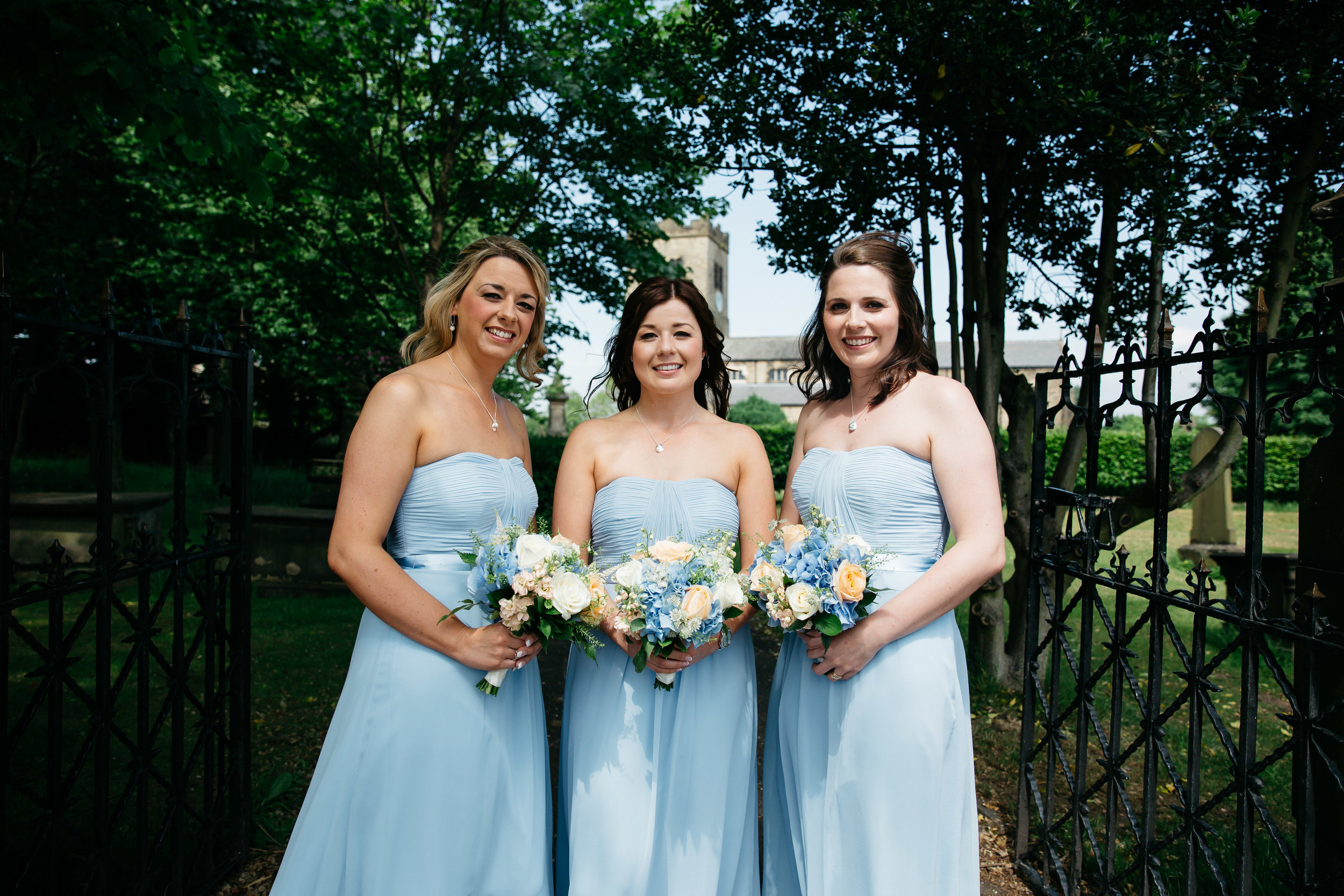 Bridesmaids outside church in Leeds