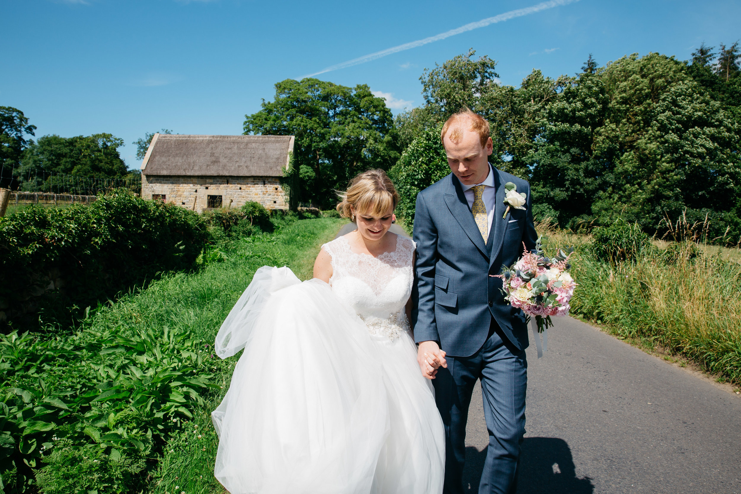 Catherine & Michael wedding day walking in Kettlesing North Yorkshire