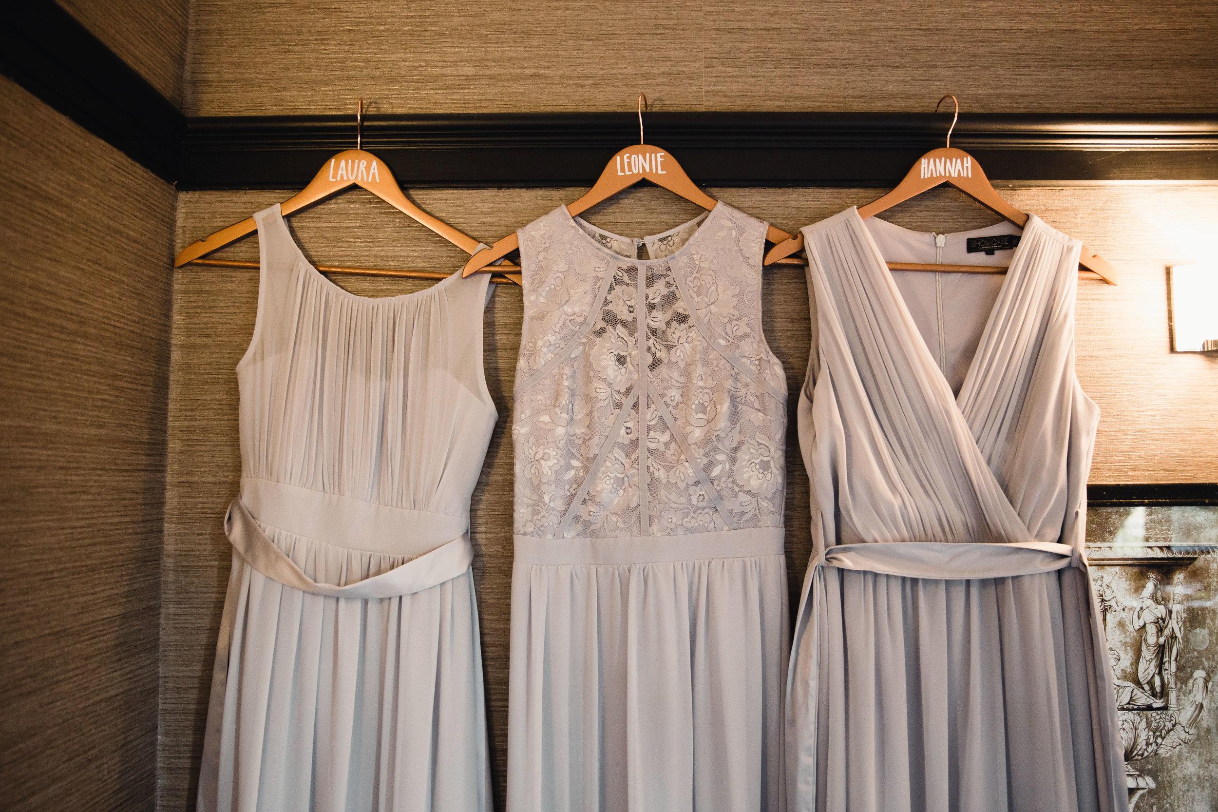 Hanging bridesmaids dresses at Falcon Manor Wedding Photography Yorkshire