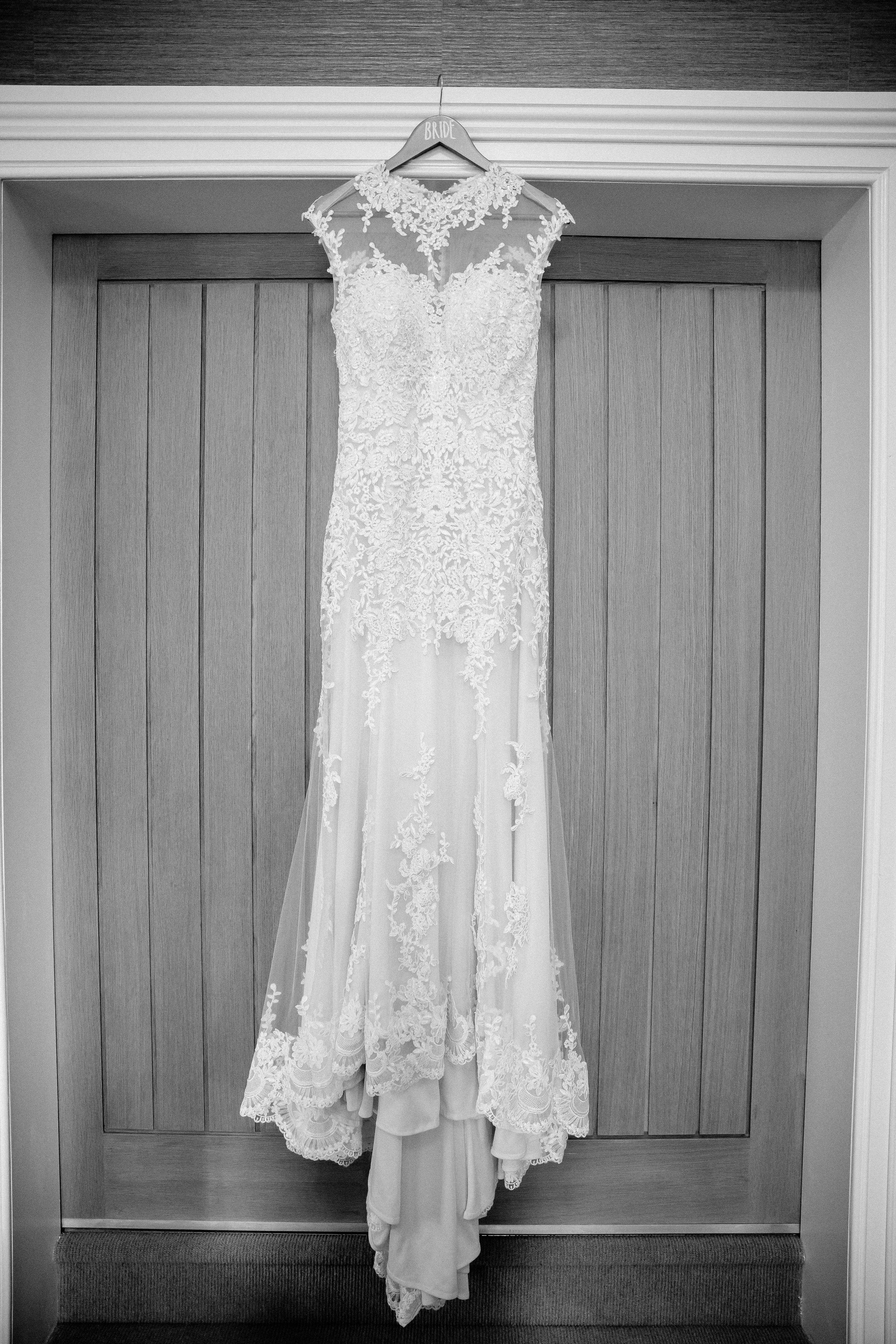 Wedding dress hanging up at Falcon Manor Wedding Photography Yorkshire