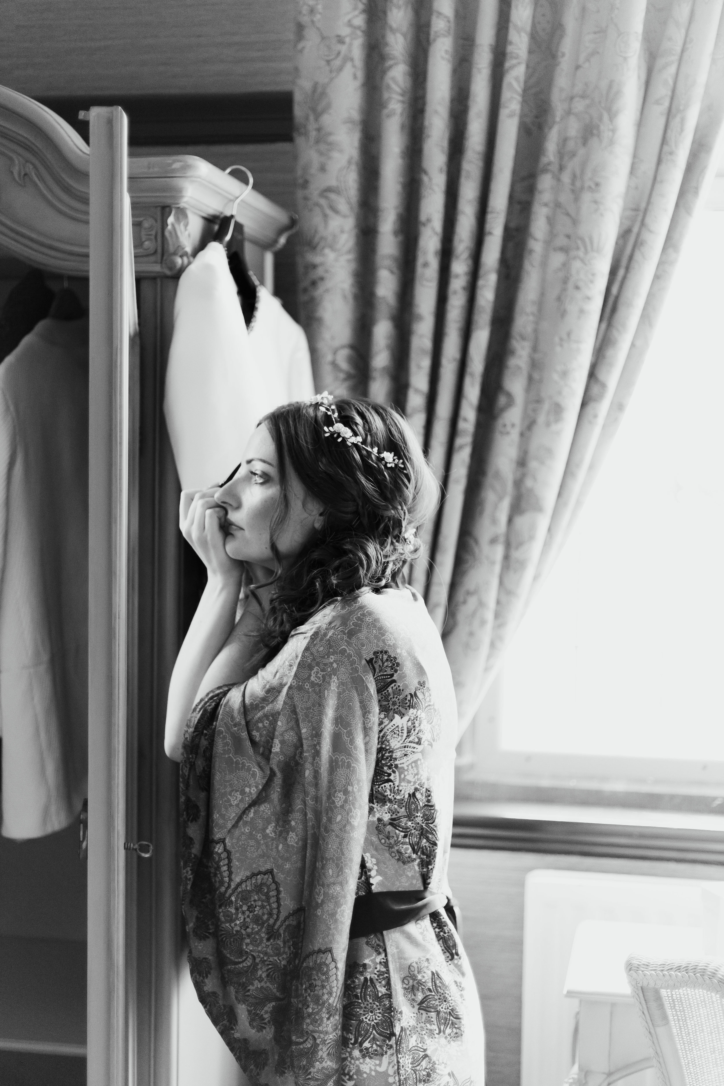 Bride touching up make up at Falcon Manor Wedding Photography Yorkshire