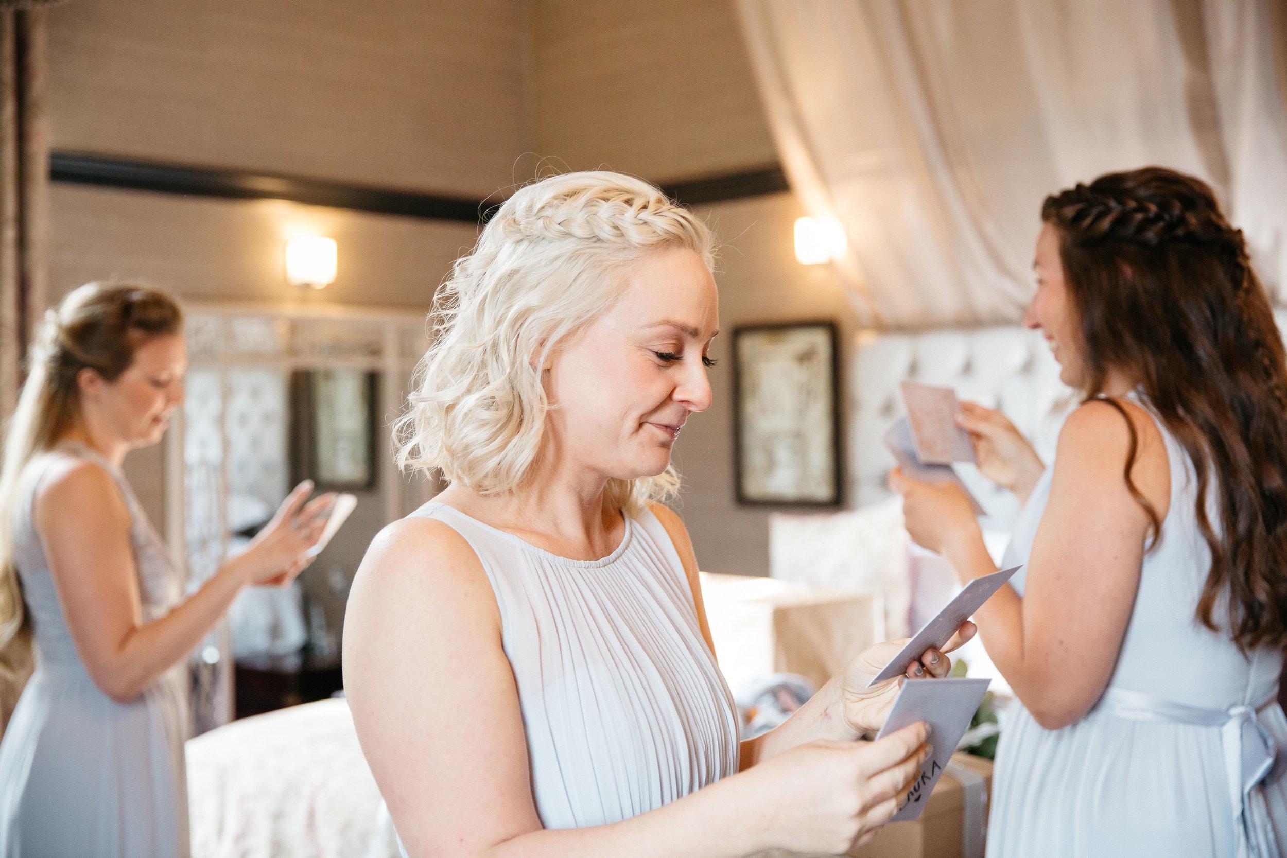 Birdesmaids opening gifts at Falcon Manor Wedding Photography Yorkshire