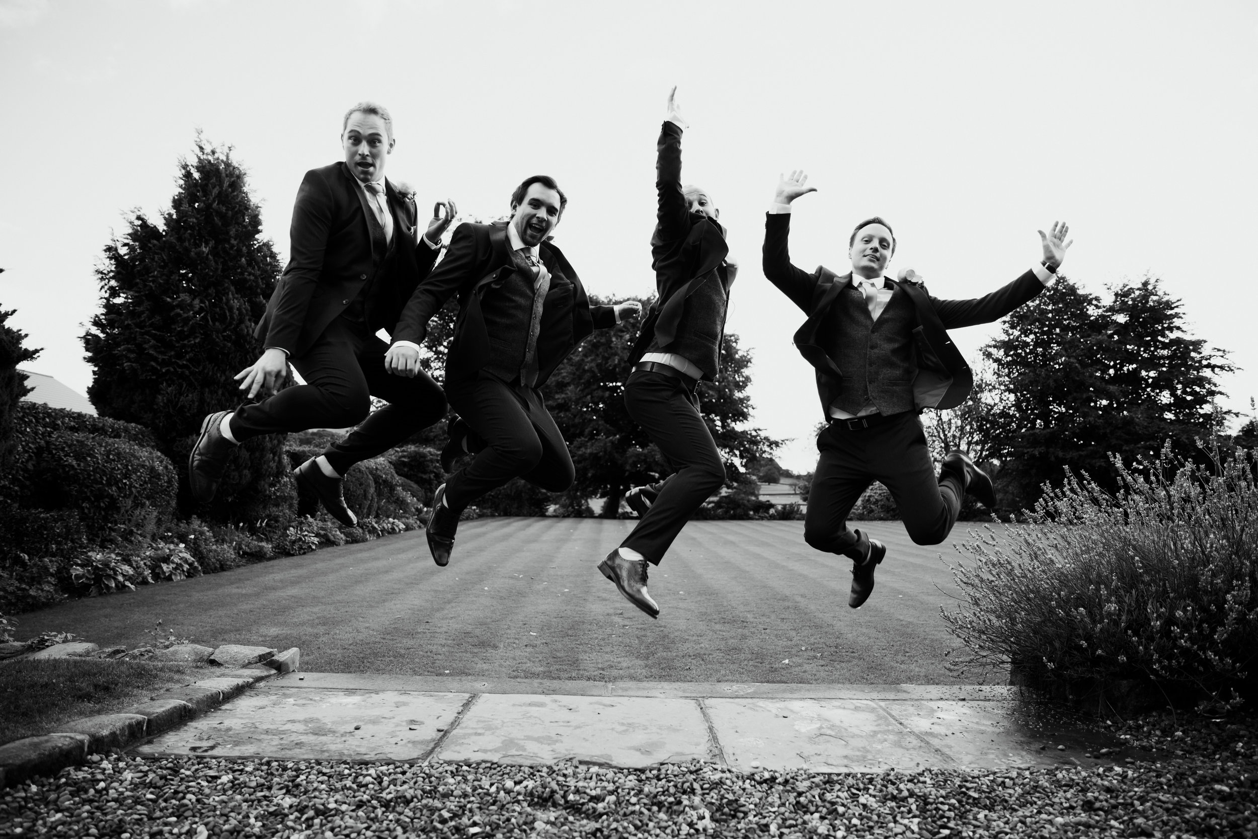 Groom and ushers JUMPING at Falcon Manor Wedding Photographer Yorkshire
