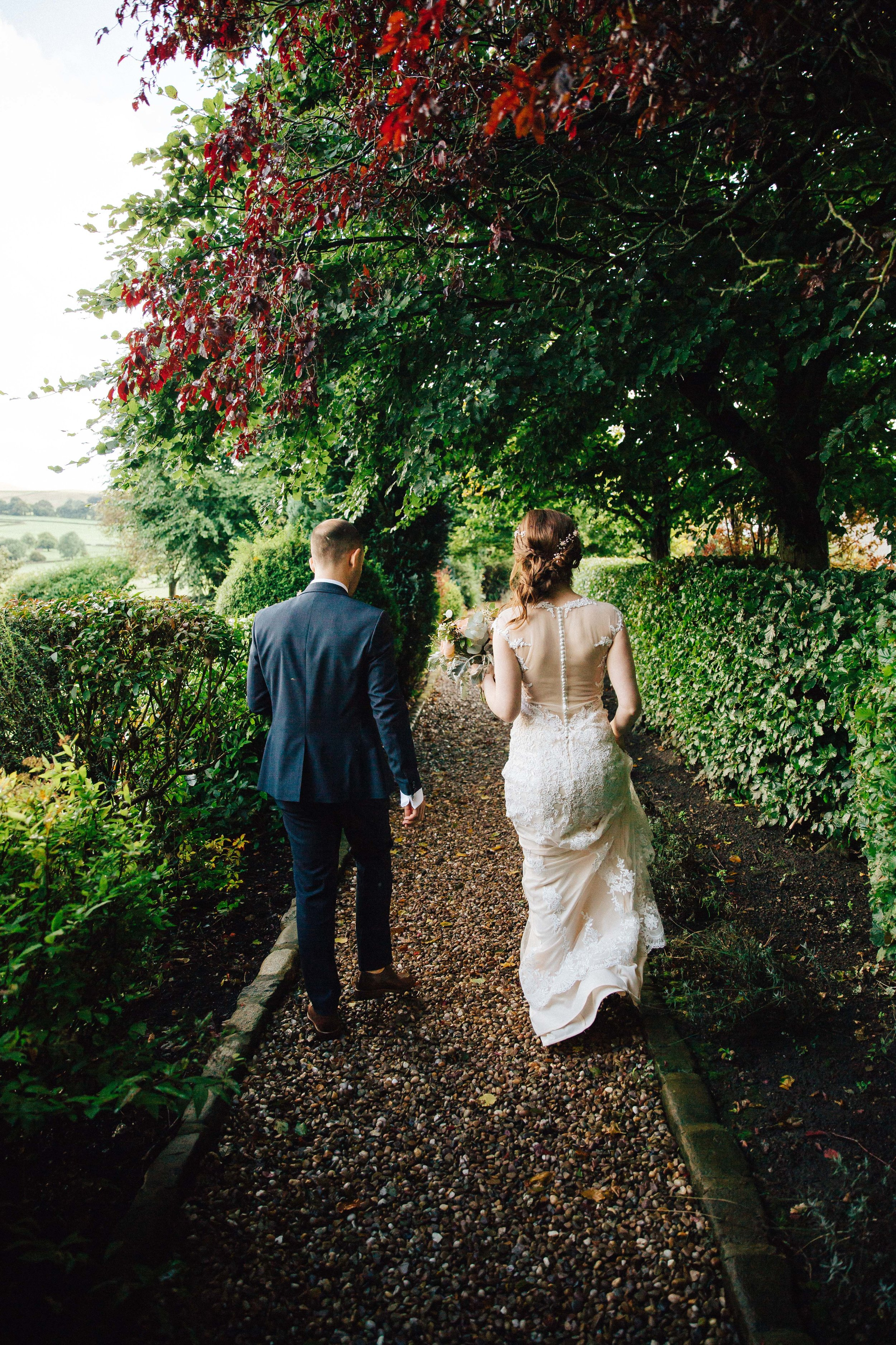 Bride and Groom walking at Falcon Manor Wedding Photographer Yorkshire